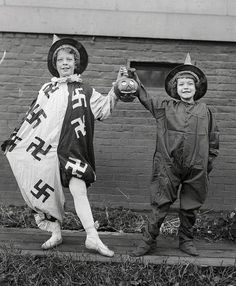 """Before Hitler ruined it, the swastika was a positive symbol with a very, very long history. This is a photo of two kids before a Halloween dance on October 25, 1918. Did you know? The word """"swastika"""" comes from the Sanskrit svastika - """"su"""" meaning """"good,"""" """"asti"""" meaning """"to be,"""" and """"ka"""" as a suffix. The swastika literally means """"to be good"""". Crazy it became the symbol of such evil!!!'"""