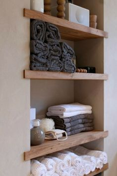 wood shelving. Reminds me of a spa.