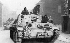 Cromwell tanks of the British 7th Armoured Division ('The Desert Rats') moving through the Dutch town of Roermond, winter 1944.