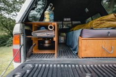 I've had quite a few questions about how I built out the back of my truck for my 4 months on the road, so here ya go. I've got rough drawings of plans, plenty of pictures, and the one of me up top looking awkward. Pickup Camping, Truck Bed Camping, Camping Hammock, Kayak Camping, Truck Bed Liner, Truck Living, Car Camper, Camper Van, Truck Caps