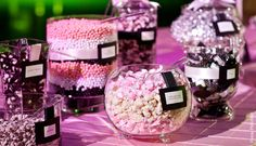 Idea for cake table: Pink and white candies among the cupcakes