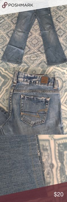 American Eagle distressed boot cut jeans Boot cut jeans with minimal distressing in a light wash. I have taken up the hem about 3 inches from the regular length (not a petite/short cut originally) they now sit across my toes; I'm 5ft for reference. American Eagle Outfitters Jeans Boot Cut