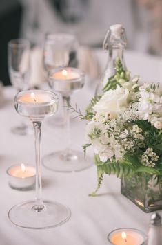 elegant candle holders, photo by Katie Slater http://ruffledblog.com/romantic-connecticut-wedding #lighting #wedding #reception
