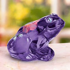 Lila, Fenton's Little Purple Hyacinth Glass Frog is an imaginative canvas for an artist's bloom of wild roses.