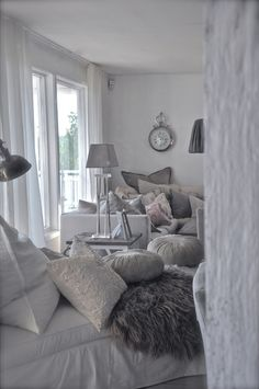 Love the look of this room - calm colours, lots of layers and squishy cushions.  www.therestfulnest.com.au