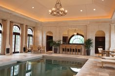 Pool room with custom cabinetry, mouldings, windows and doors.