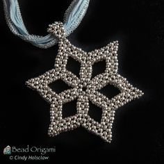 Snowflake Pendant by Cindy Holsclaw Beaded Crafts, Beaded Ornaments, Jewelry Crafts, Christmas Ornaments, Seed Bead Patterns, Beaded Jewelry Patterns, Snowflake Jewelry, Bead Weaving, Beadwork