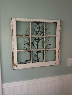 Old window decoration with chandelier decal instead of tree?