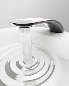 Simin Qiu has created a unique design for a bathroom tap which not only looks stylish, but helps save resources by turning the stream of water into an elegant, captivating 'net' spiral. A special turbine saves 15% more water than with an ordinary tap.