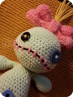 """PDF INSTRUCTIONS ONLY for Amigurumi Scrump, inspired by Lilos little Voodoo doll from Lilo and Stitch  ~Dimensions~ The finished amigurumi is about 24cm (9.5"""") without the bow and hair (which are about 14cm/5.5"""") tall. The size though may differ, depending on the yarn and hook size you use.  ~Difficulty~ Beginner - Intermediate  ~Materials~ • Crochet hook 3.5mm & 4mm • Yarn in Mint Green, Pink, Yellow (for the hair) and a piece of Black (for the mouth) • Stuffing • Three buttons, one in…"""