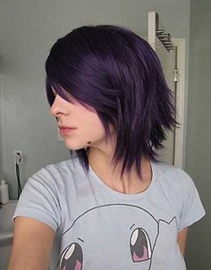 Short purple choppy bob...