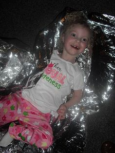 $2 space blanket makes a great sensory toy for kiddos with special needs!