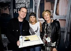 Miranda Lambert gets caked by the venue's Tom Alexander and Director of Public Assembly Facilities Kim Bedier during a stop at the Tacoma Dome in Washington Feb. 13.
