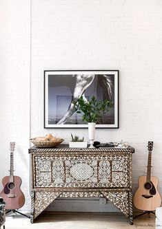 Laura Ferrara's apartment, guitars / Garance Doré Antique 19th Century Syrian bridal chest inlaid with mother of pearl.