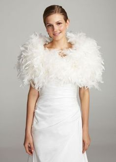 """Fun feather wrap is perfect for any true fashionista looking to stand out on her wedding day!  Feather wrap with satin lining is perfect for making a fashion statement.  Available in Ivory.  Dimensions: 33""""L x 8 1/2""""W  Fully lined. Imported."""
