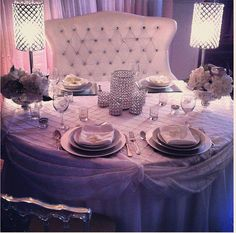sweetheart table at wedding reception but i dont like the lamps or table decoration