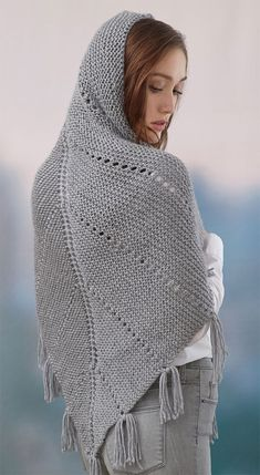 Free Knitting Pattern for Easy Hoodie Shawl - This easy shawl is knit in garter stitch with rows of eyelets. Wear it as a regular wrap or with hood up. Designed by Erin Kate Archer for Red Heart. Rated easy by the designer. Worsted weight yarn.