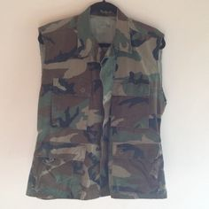 Genuine US Army Camo Vest This Army vest is the real deal! Woodland camouflage. Men's small/extra short, tag has the exact measurements. Depending on how you see yourself wearing this, could work for women's S-L. Put a belt around it with some high heeled boots or wear as intended as an outerwear layer. Jackets & Coats Vests