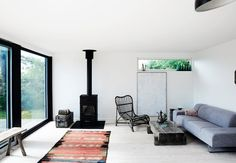 This modern living room is furnished with a few well-chosen furniture that supports the simple and nordic style.