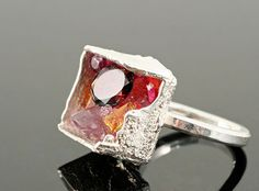 Ring, Boxcast by Kelvin Birk,  Cut garnet, 2 citrine, amathyst, small ruby, ruby crystal, stone cluster