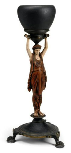 A FRENCH PAINTED SPELTER FIGURAL STAND - LATE 19TH CENTURY