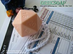 D20 GEEKSOAP On A Rope always scores a critical hit against bad body odor. This large, one-of-a-kind solid soap features 20 sides of cleanliness with a sturdy hand-crocheted cotton rope that makes it convenient to hang in your dungeon... erm, I mean shower! Weighs 4oz.