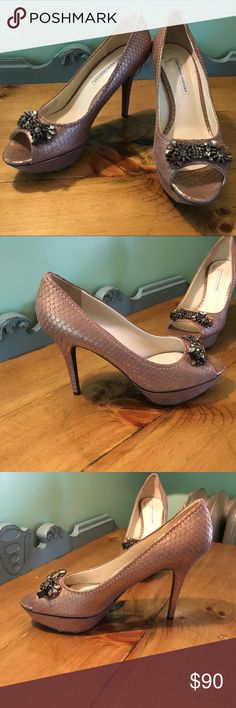 """Vera Wang Lavender  Rose Gold Heels Absolutely beautiful heels that are perfect for your prom, wedding, or any special occasion! The shoe is a rose gold color in a snakeskin pattern. The top of each shoe has beautiful jewel accents! The heel is a little over 4"""" with a 1"""" platform. Leather Upper.Leather Sole. Bottom and inside of shoe shoes wear ( see pictures).Missing one row of gems ( shown in picture). Vera Wang Shoes Heels"""