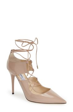 Sexy, and alluring—these corset-inspired Jimmy Choo patent nude pumps are a foolproof way to edge up any fabulous ensemble.