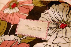 Typewritten fabric labels!  I've printed on fabric using an inkjet printer before, but hadn't thought of using my vintage typewriter. . .  I'll have to give this one a go!  Maybe for luggage labels?