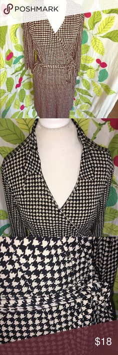 "Houndstooth Wrap Dress Black & cream houndstooth print wrap dress with long adjustable tie fabric belt. Runs true to size but can fit a range of sizes due to the flexible fabric, open front and wrap style. Polyester/spandex. Just enough stretch to be so comfy & flattering. Hits my calf and I am 5'6"". 45"" from shoulder to hem. 3/4 length sleeves. Please see my other dresses. BUNDLE & SAVE 20%!! Dresses Midi"