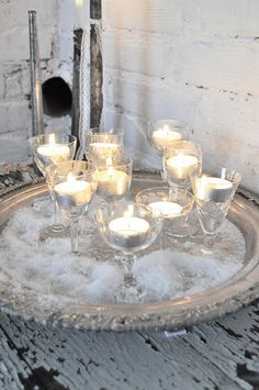 votives in wine glasses on a silver tray <3