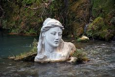 Modern bust of the nymph Herkyna at Herkyna headwaters, Livadia, Greece by Spyros Gourgiotis