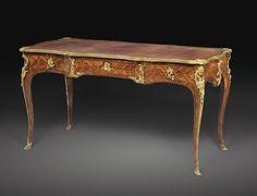 Important bureau plat en placage de satiné et marqueterie de bois de bout et monture de bronze doré d'époque Louis XV, estampillé deux fois<em>BVRB, vers 1730</em> | Lot | Sotheby's