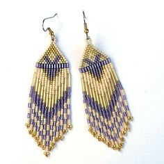 Long Native American  Seed Bead Earrings in cream, gold and violet tones. $19.00, via Etsy.