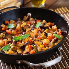 Italian Caponata with frying pan on a wooden background by Timolina. Italian Caponata with frying pan on a wooden background Eggplant Caponata, Smitten Kitchen, Fake Food, Serving Dishes, Plant Based Recipes, Italian Recipes, Crockpot Recipes, Entrees, Fries