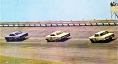 Fireball Roberts, Fred Lorenzen and David Pearson going through the first and second turns at Darlington Raceway 1963..