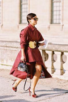 Burgundy coat. Golden belt