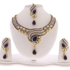 Stunning Designer Necklace set with dangle earrings and Maang Tikka studded with Simulated White, Royal Blue CZs and Kundan.Gorgeous necklace in Gold Tone, handcrafted with High quality CZs and Kundan.Earrings - Measures (approx) x OR 2 Bridal Necklace, Necklace Set, India Jewelry, Necklace Designs, Anklet, Bling Bling, Jewelry Ideas, Royal Blue, Dangle Earrings