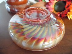 I couldnt put this iridescent orange peacock glass bowl under the Kitchen and Dining category. It has to go in Home Decor. Its too beautiful to