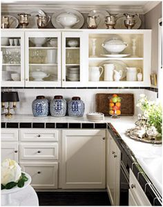 silver/ pewter display What should you do with the awkward space above kitchen cabinets? | Essence Design Studios, LLC