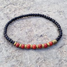 Ebony is said to bring strength to the wearer, being one of the densest, strongest woods, historically used to make Samurai swords... Red jasper is a strong protection gemstone, it is said to absorb n