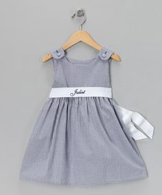 This breezy little dress features a high waist, coordinating sash and covered button shoulder closures. It also makes for a perfect party frock and can be personalized with the name of the sweetie who's wearing it.