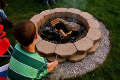 Easy, simple & cheap fire pit.  I would do playchips around the outside as I hate gravel in the grass.