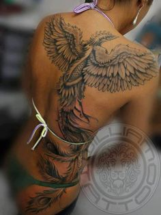 Black ink phoenix tattoo on back