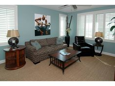 Blue Family Room with soulful artwork - The Dunes - Naples, FL