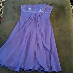 Purple Davids Bridal bridesmaid dress David Bridal purple dress with sequin top, length is to the knee cap. Two small water stains, so light they don't show in a picture and aren't noticeable while wearing the dress. Davids Bridal Dresses