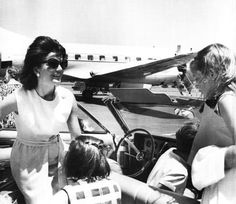 """youngfirstlady:  """" Mrs. Kennedy arrives at Barnstable Muncicipal Airport to spend a month at the Kennedy Compound in Hyannis Port. She was accompanied by, John Jr. in the front seat and Caroline facing her in the rear seat. At the right side of the..."""