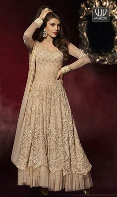 Priyanka Chopra Beige Net Anarkali Designer Salwar Kameez  Priyanka chopra beige net anarkali designer salwar kameez with resham work, lace and stones work seems to be chic and aspiration for any event.
