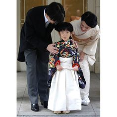 Japan's Prince Hisahito, wearing traditional ceremonial attire, is accompanied by his father Prince Akishino and mother Princess Kiko after the Chakko-no-Gi and Fukasogi-no-gi ceremonies at the Akasaka imperial estate in Tokyo.