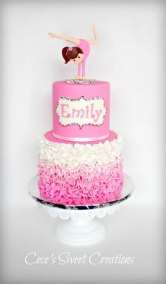 Gymnastic Pink Ruffle Cake A simple pink ombre ruffle cake and a gymnastics girl topper to represent Emily… Everything is edible...